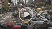 Mid-day traffic crosses the Queensboro Bridge, which spans the East River between the boroughs of Manhattan and Queens in New York City, while the Roo...