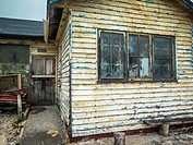 An old wooden bungalow much in need of some care and a nd a coat of paint
