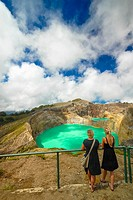 tourists at colourful volcanic lake of kelimutu volcano at flores indonesia