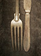 Still life with silverware on table. Knife and fork on a stone background.