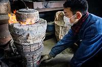 baking the outer mold, to resist the molten iron and make a iron teapot or tetsubin, nanbu tekki,Workshop of Koizumi family,craftsmen since 1659, Mori...