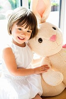Sweet toddler girl with her Easter bunny.