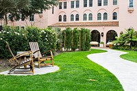 Outdoor of the luxurious Fairmont Spa and Mission Inn in California. 2 chairs and a table made out of wine barrels on a sunny day. No people
