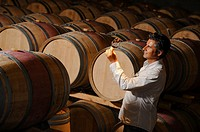 Tourism - Man tasting wine in a cellar-Winemaker.