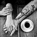 Hands and coffee.
