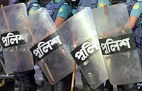 Bangladeshi police person stand guard in front of Bangladesh Nationalist Party (BNP) head office, during a nationwide strike called by the opposition ...