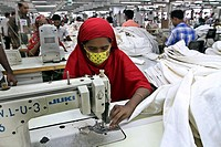 . BANGLADESH, Dhaka : Bangladeshi woman works in a garments factory in Ashulia Savar in Dhaka on September 24, 2013. Photo by palash khan.