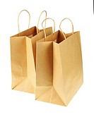 Empty brown recycled paper shopping bags isolated on white background. Side view from top.