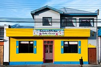 Brightly-painted home and shopfront in Punta Arenas, Patagonia, Chile.