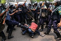 Dhaka 10 May 2015: Police maul protesters during a march to besiege Dhaka police headquarters demanding action over the sexual assault on women during...