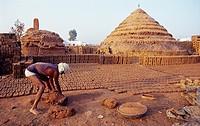Worker in a brickyard ( India).