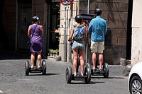tourists riding segway transporters in Rome, Italy.
