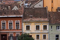 Old architectural building facades and rooftops in the town of Brasov, Romania, Eastern Europe.