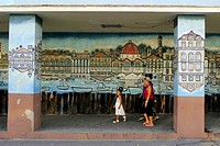 Street scene wall mural local scene young girl two women Cienfuegos Cuba.