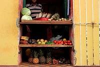 Street scene colorful houses small shop Trinidad Cuba.