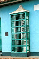 Windows covered with shutters and wooden bars on the Plaza Mayor, Trinidad, Cuba