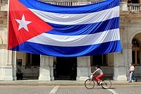 Large Cuban flag hangs from building Santa Clara Cuba.