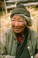 Very old woman, still working for her village. Paro Valley, Bhutan