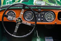 Dashboard of a green Morgan 4 British Sports Car at a show in Vancouver.