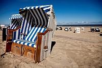 Strandkorb - beach chairs on the main beach, East Frisian Island Spiekeroog, Lower Saxony, Germany.