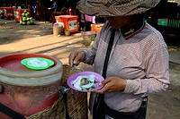 Woman selling exotic products, Siem Reap, Cambodia