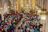 "Detroit, Michigan - A """"mass mob"""" fills Ste. Anne de Detroit Catholic Church for Sunday morning mass. Organizers try to fill one of Detroit´s histori..."