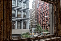 Looking out the window of a Flat Iron building at the Flatiron District of New York City, on a Rainy Day.