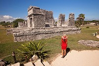 Tourists in Mayan Ruins at Maya archeological site of Tulum, Quintana Roo, Yucatan Province, Mexico, Central America.