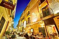 Restaurant terraces at Loreto street by night. Denia. Alicante. Valencia Community. Spain.
