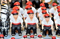 ´Caganers´, particular feature of modern nativity scenes at Santa Llucia Christmas fair, Barcelona. Catalonia, Spain.