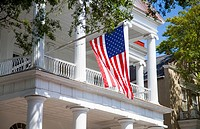 Southern Historic patriotic home flying American flag in Charleston, South Carolina USA.