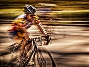 Pan shot of man on bicycle, Central Park, NYC, USA