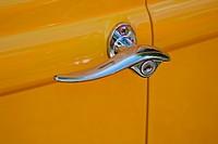 Chrome handle on antique yellow car door
