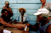 Old men playing dominos on street in Trinidad, Cuba, West Indies, Central America.