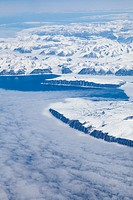 Flying over the west coast of southern Greenland in a commercial jet aircraft LHR to YVR.