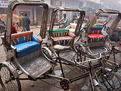 Parked pedicabs and busy street, Varanasi, Uttar Pradesh, India
