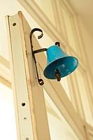 Door of shop standing ajar. Bell on door to let shopkeeper know when someone is coming in.