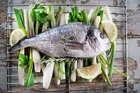 Presentation and preparation of a second dish of sea bream and onions.