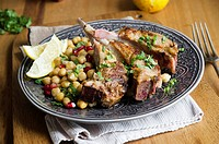 Harissa lamb with chickpeas and pomegranate seeds.