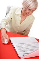 Elderly business woman using a laptop computer.