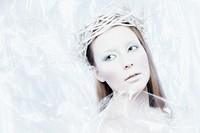 Fantasy ice queen theme, young beautiful woman, studio shot.
