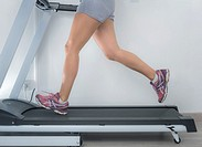 Woman on a running machine.