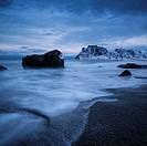 Rocky shore of Uttakleiv beach in winter, Vestvågøy, Lofoten Islands, Norway.