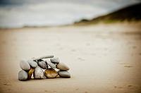 Twelve stones on a beach. Ireland.