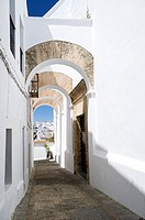 Elegant arched architecture in the narrow lanes of the picturesque village of Vejer de la Frontera, voted by the Spanish as the most beautiful village...