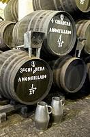 Sherry making in the Criadera e Solera method barrels three high in the bodega of Tradition, Jerez,bSpain.