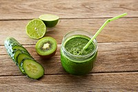 Detox green juice cleansing recipe with also kiwi lemon cucumber spinach.