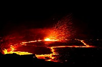 Active pit crater glowing at night, Erta Ale volcano in the Danakil depression, Ethiopia, Africa.