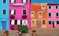Brightly painted houses in pretty square, Burano, Venetian Lagoon, Veneto, Italy, Europe.