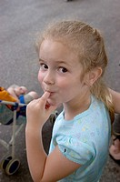 Young girl looking coy with finger in her mouth
